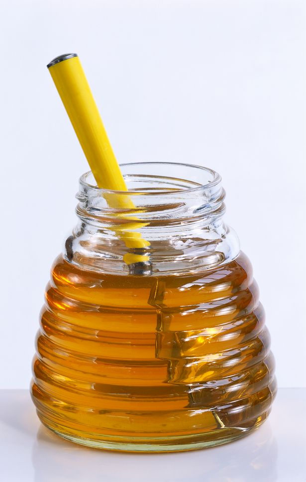 1_Glass-jar-with-honey-and-spoon-close-up.jpg